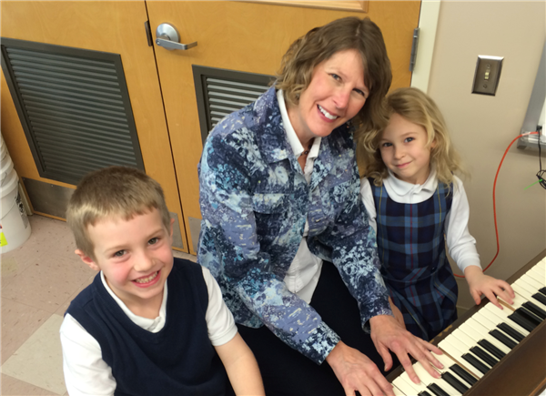 Mrs. Capozzi at the piano with students